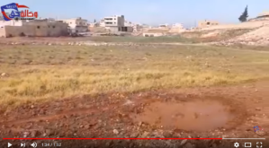 The picture of the crater with the puddle of water in Saraqeb dated 02/04/2018