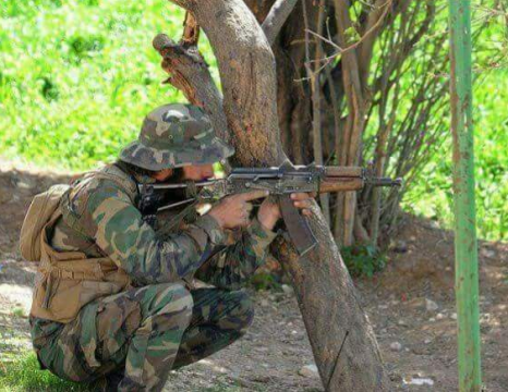A Syrian soldier engaged in offensive actions
